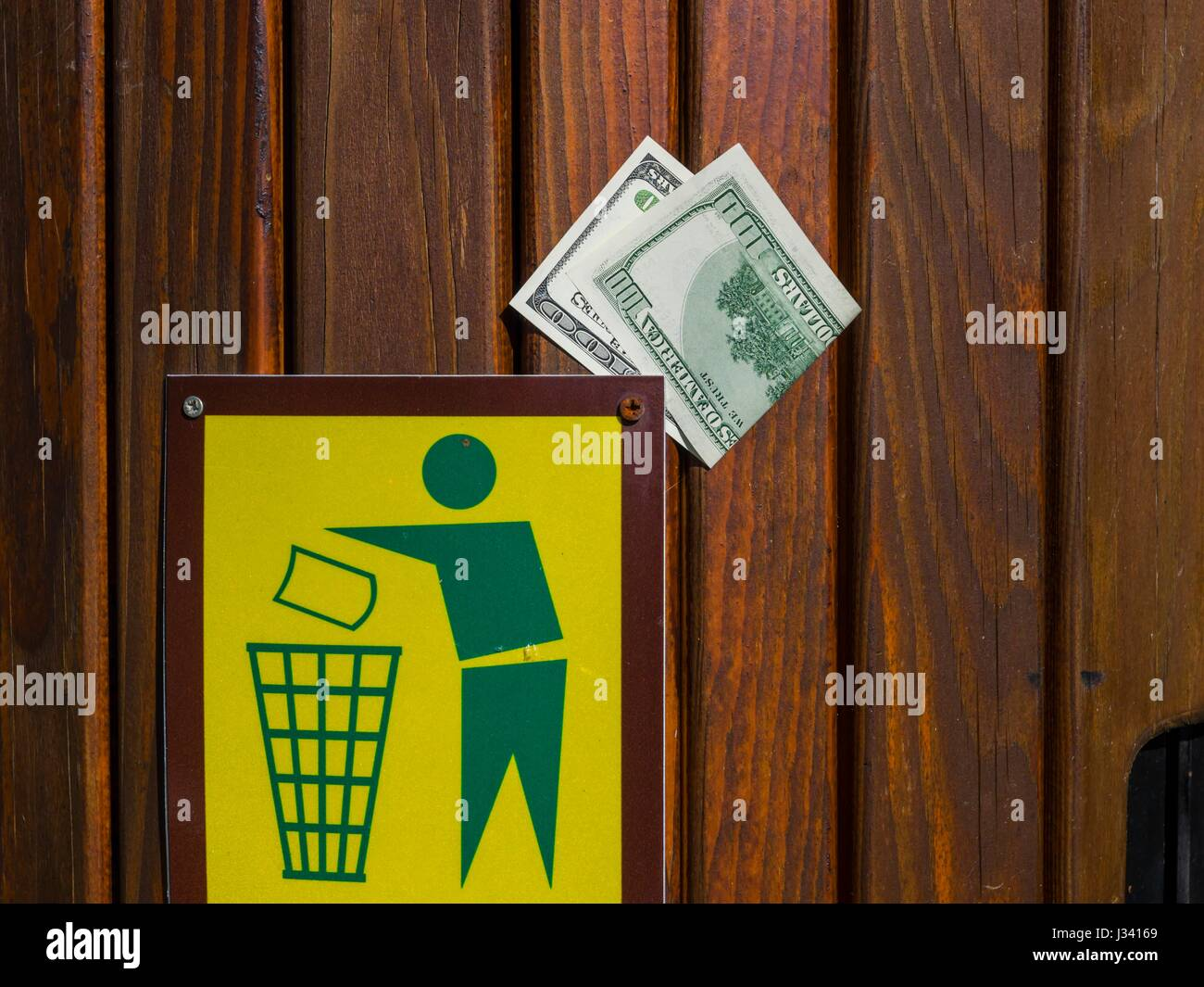 Natural environmental issues cost money, throw thrown-away discarded discard value , valuable valuables - Stock Image