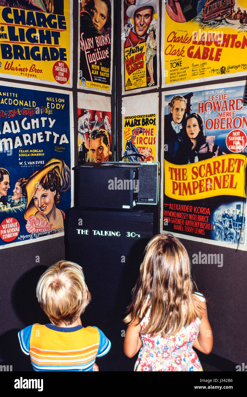 Two children of the 80's listening to the story of film development in the 1930's, Sydney, Australia. - Stock Image