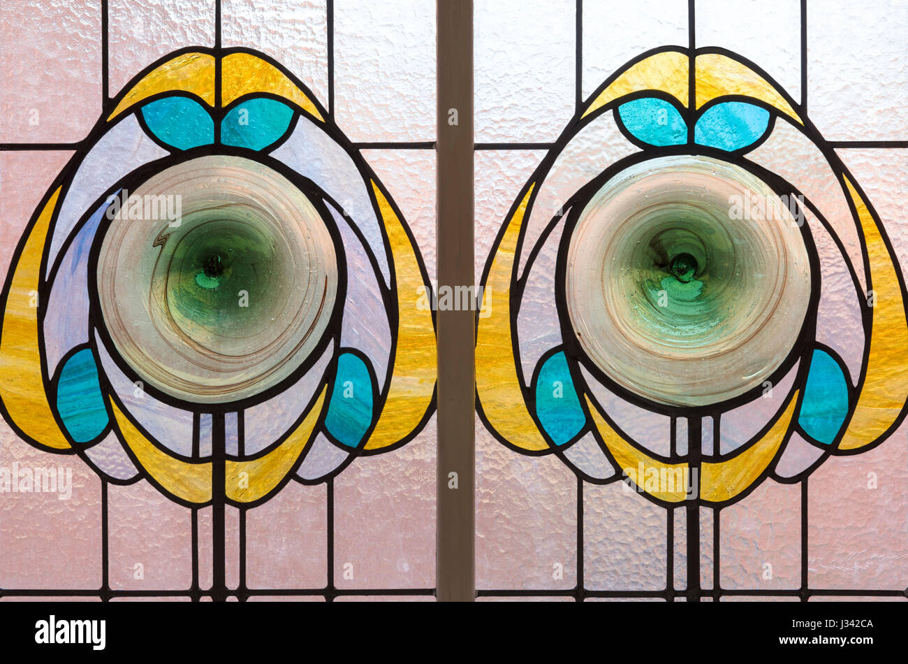 Stylised flowers depicted in stained glass, Victoria Baths, Manchester, England. - Stock Image