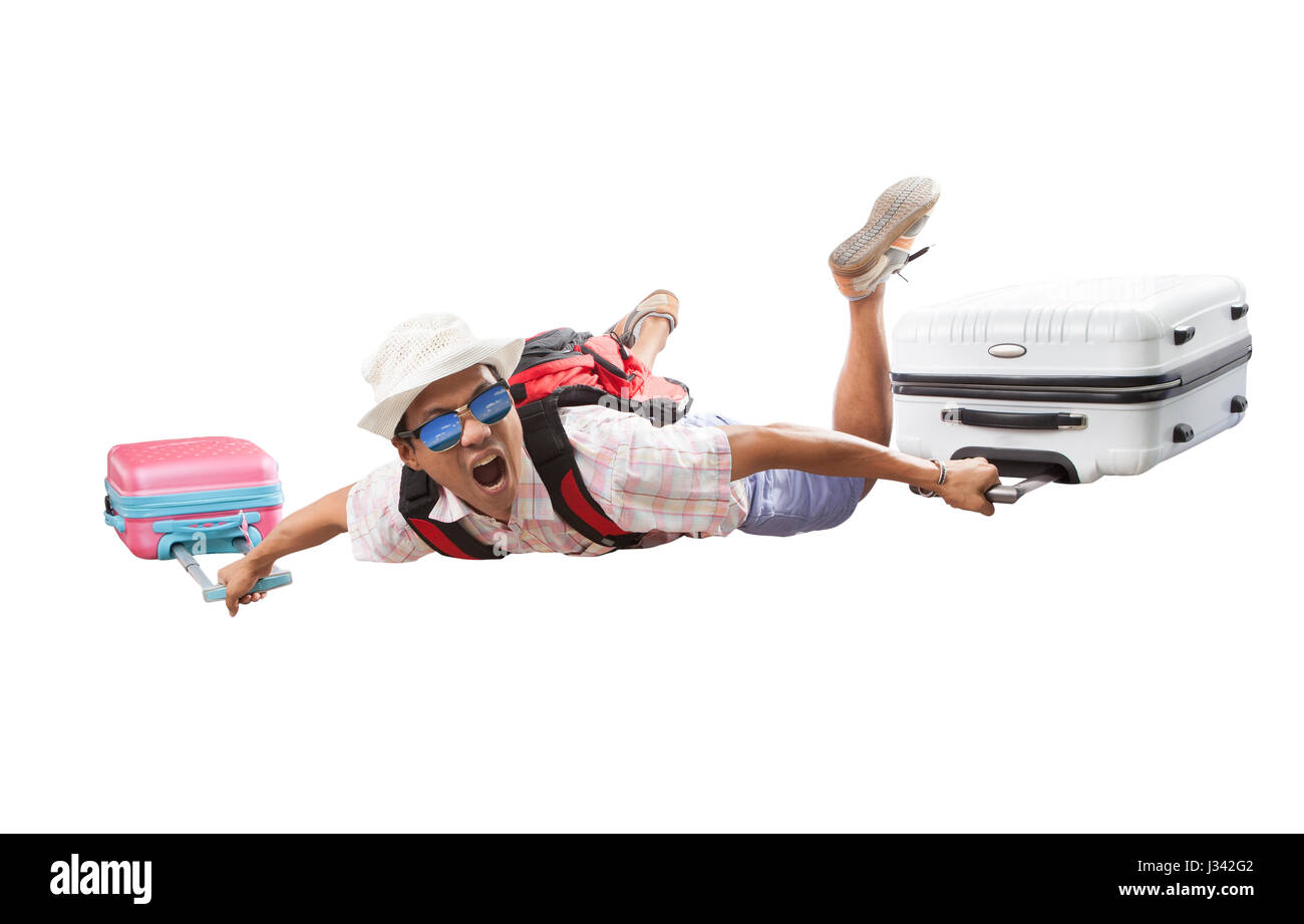 young asian traveling man and luggage flying happiness emotion summer vacation time  isolated white background - Stock Image