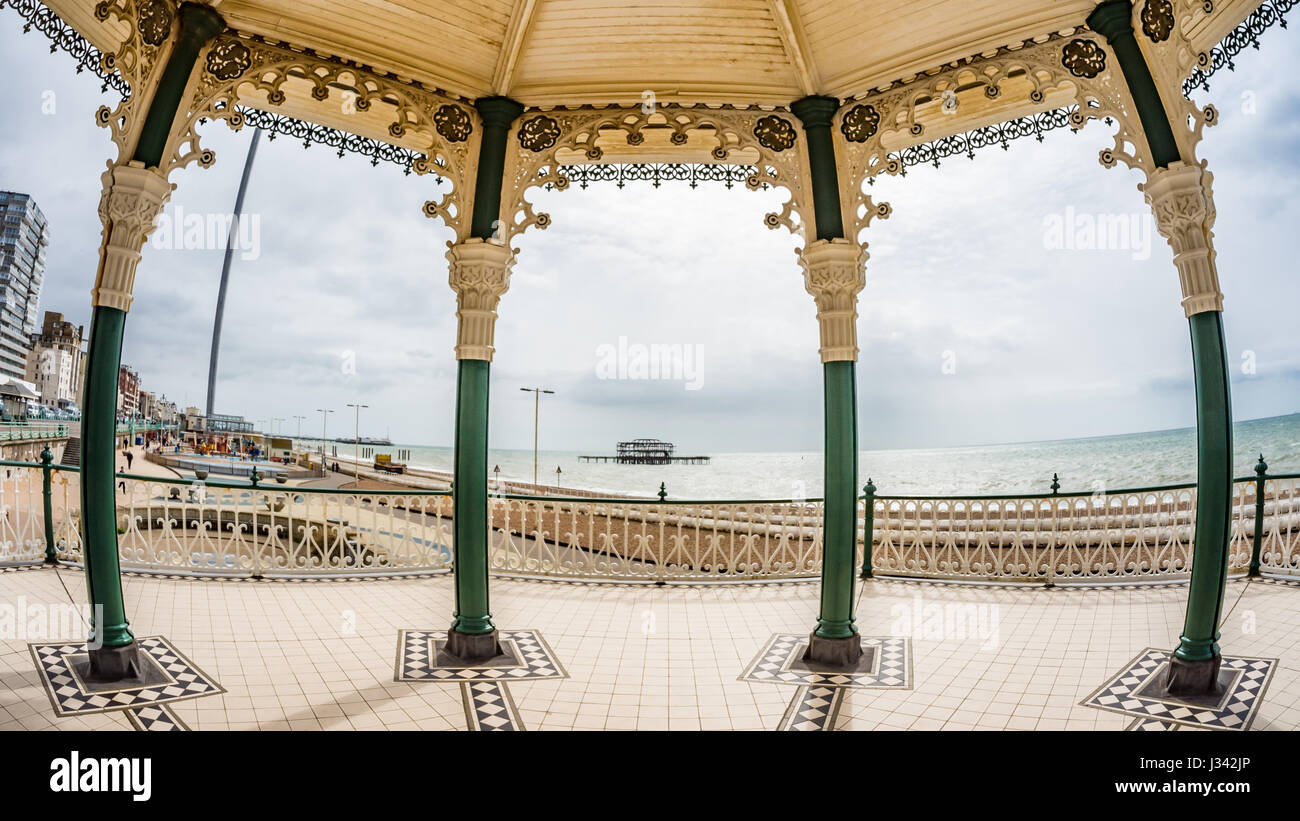 Fish eye view of the Victorian bandstand and the remains of the destroyed West pier in Brighton and Hove (UK) - Stock Image