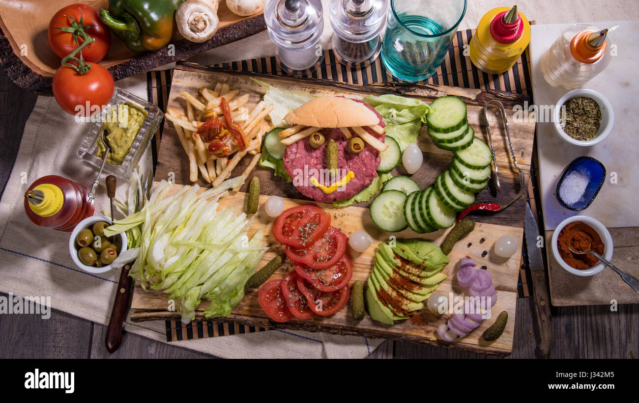 Top down view of a happy smiling burger - Stock Image