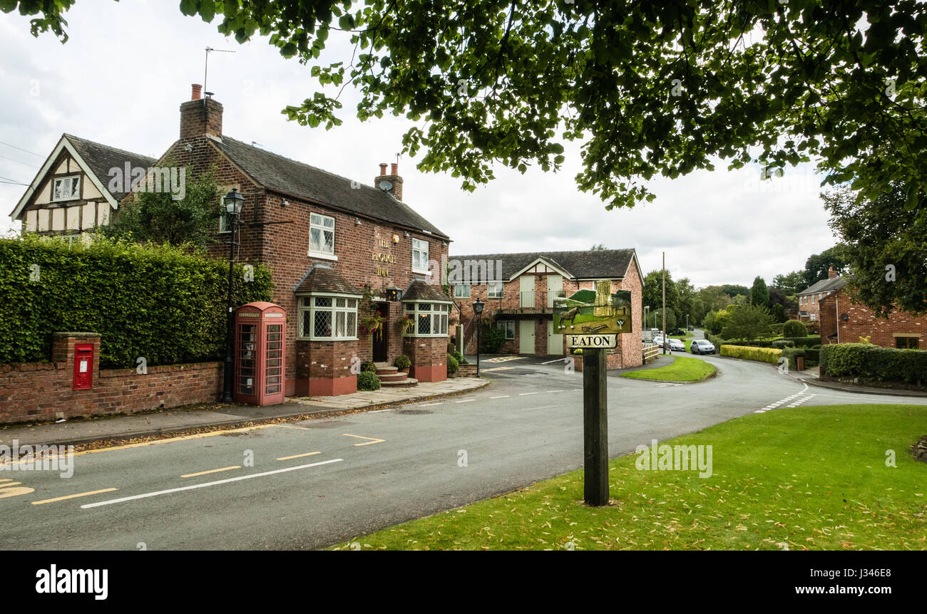 The village of Eaton, village sign and local pub 'The Plough' - Stock Image