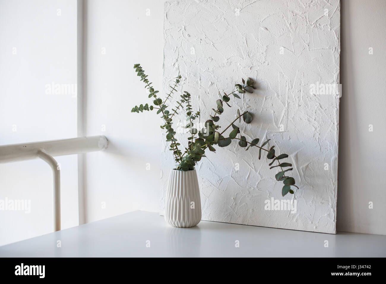 Minimalist Home Interior Decor Branches In Vase On Table In White