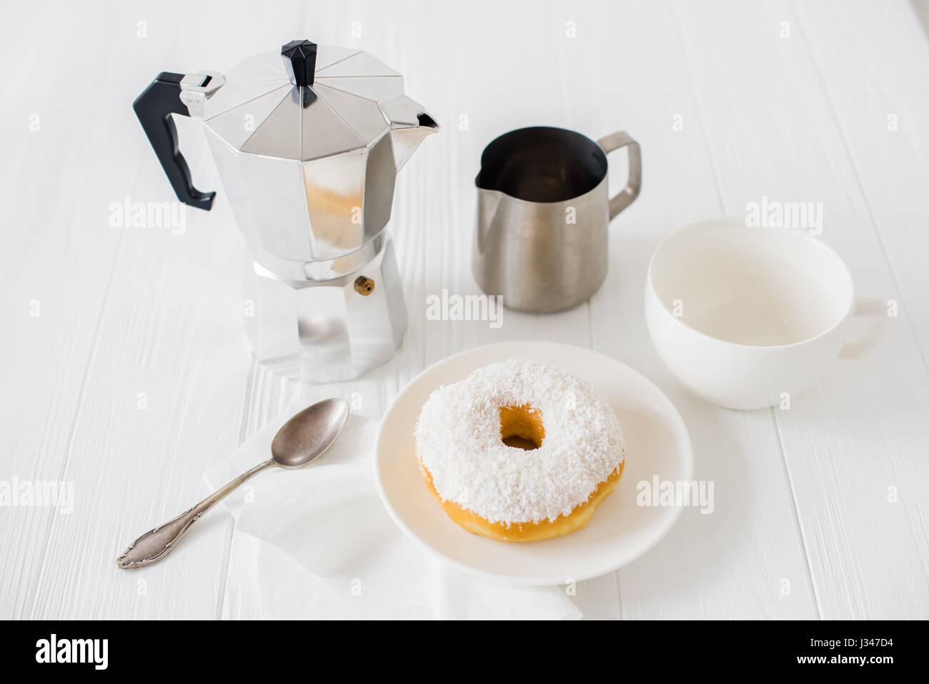 Elegant white breakfast table setting coffee cup and donut close-up & Elegant white breakfast table setting coffee cup and donut close-up ...