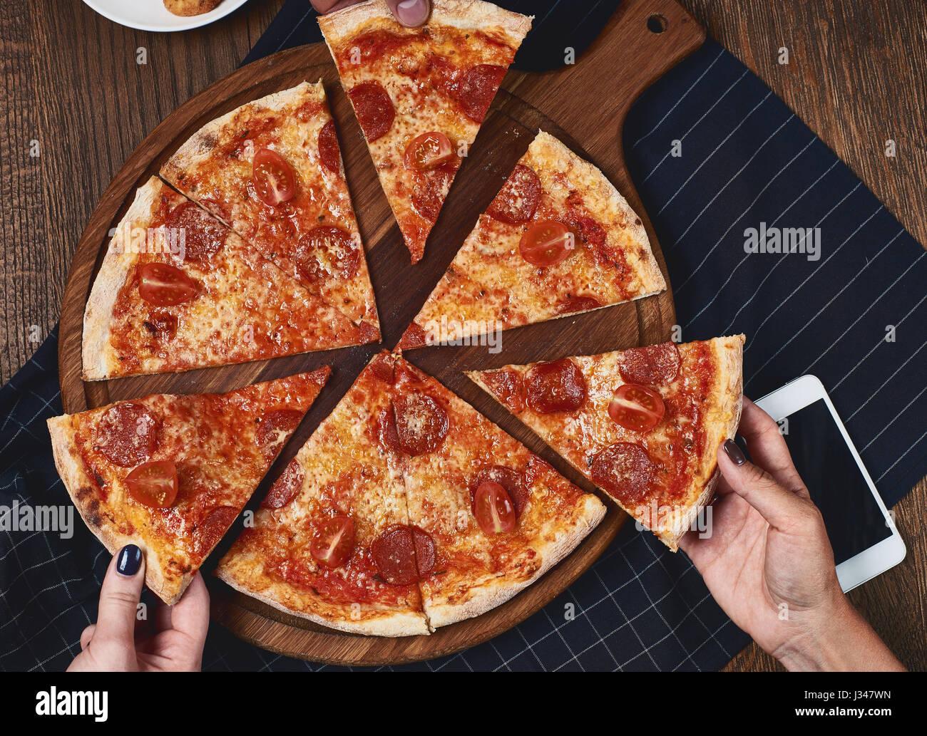 Flatlay. Friends eat pizza. Stock Photo