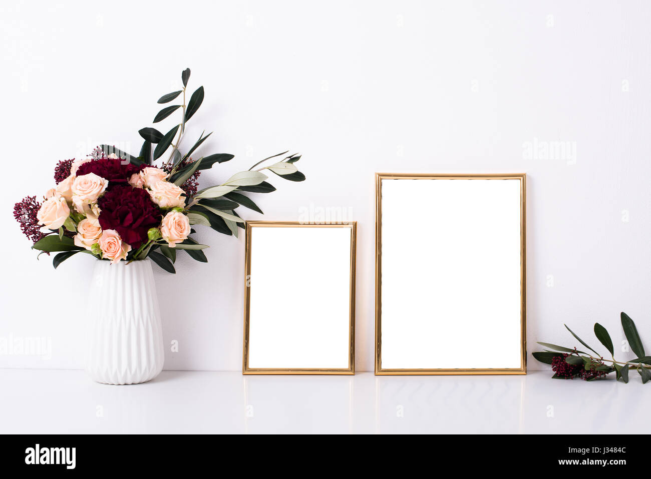 Two golden frames mock-up on white wall background, home decor with ...