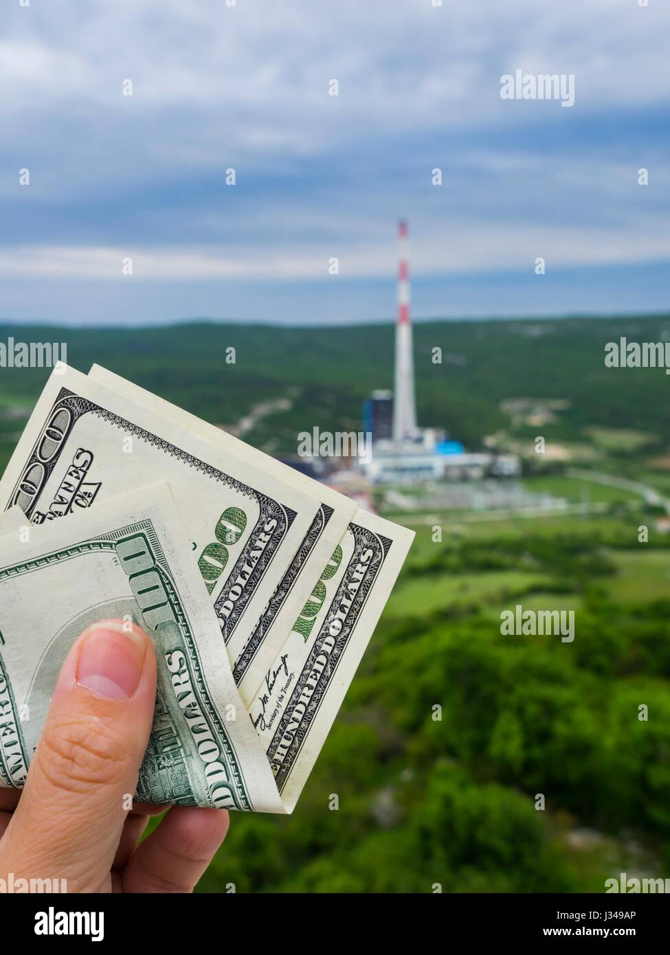 Cost of industry industrial growth and environmental risk risky funding fund unhealthy health , value valued , valuable - Stock Image