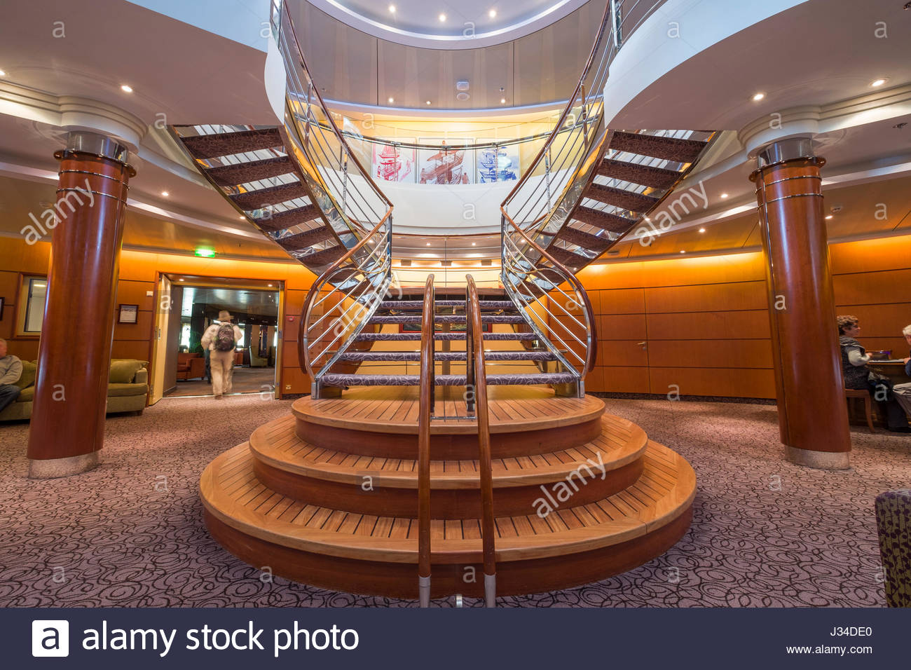 Ornate Staircase In The Atrium Aboard The Regent Seven Seas Mariner Cruise  Ship, North Atlantic