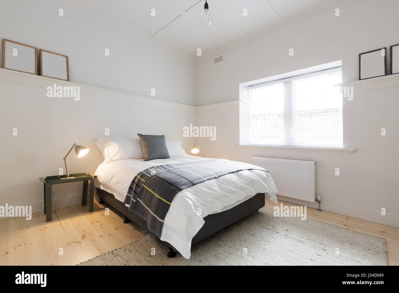 Danish contemporary styled guest bedroom in luxury renovated modern  Ausrtralian apartment. Danish contemporary styled guest bedroom in luxury renovated modern