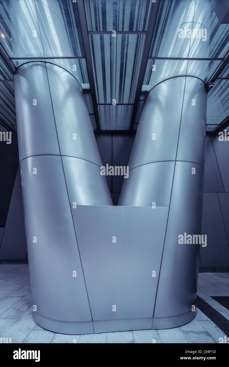 Metal column/pillar in modern futuristic architecture. Public/office building interior fragment Stock Photo