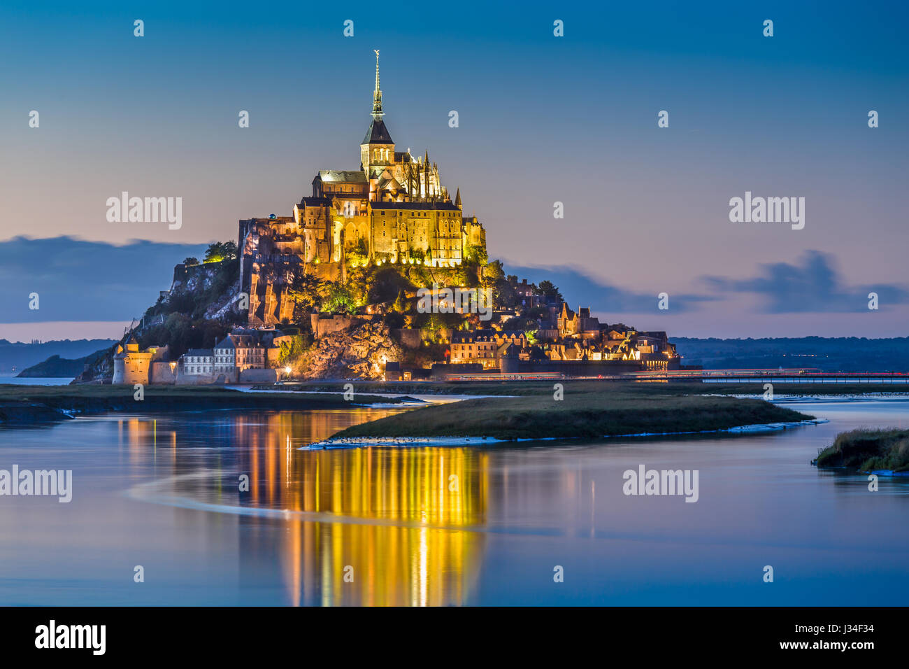 Beautiful view of famous Le Mont Saint-Michel tidal island in beautiful twilight during blue hour at dusk, Normandy, - Stock Image