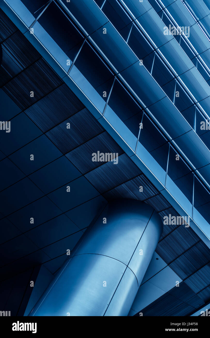 Metal column/pillar and part of the building in modern futuristic architecture. Public/office building exterior Stock Photo