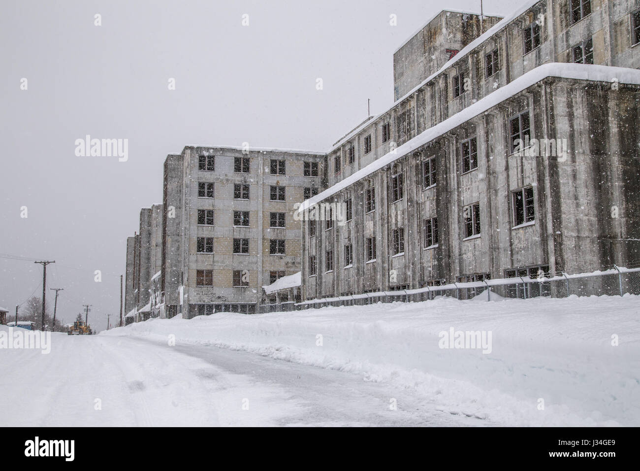 The Buckner Building in the snow, an abandoned former U.S. military building in Whittier, Alaska, USA - Stock Image