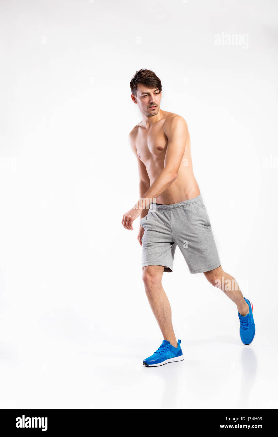 487931b20d6ef Shirtless fitness man in gray shorts. Studio shot. - Stock Image