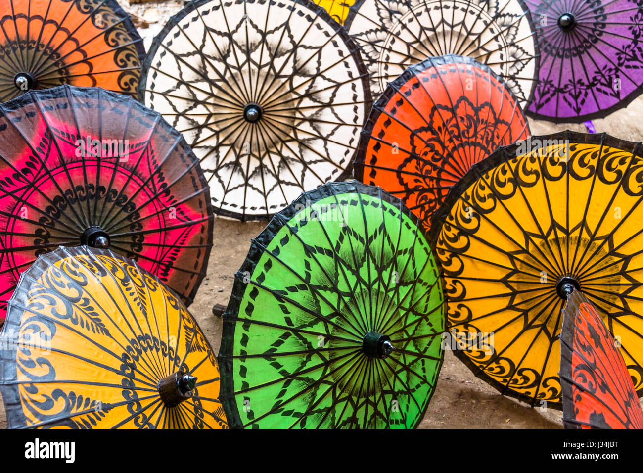 Colourful, hand-crafted Parasols are popular souvenirs for travellers to Myanmar - Stock Image