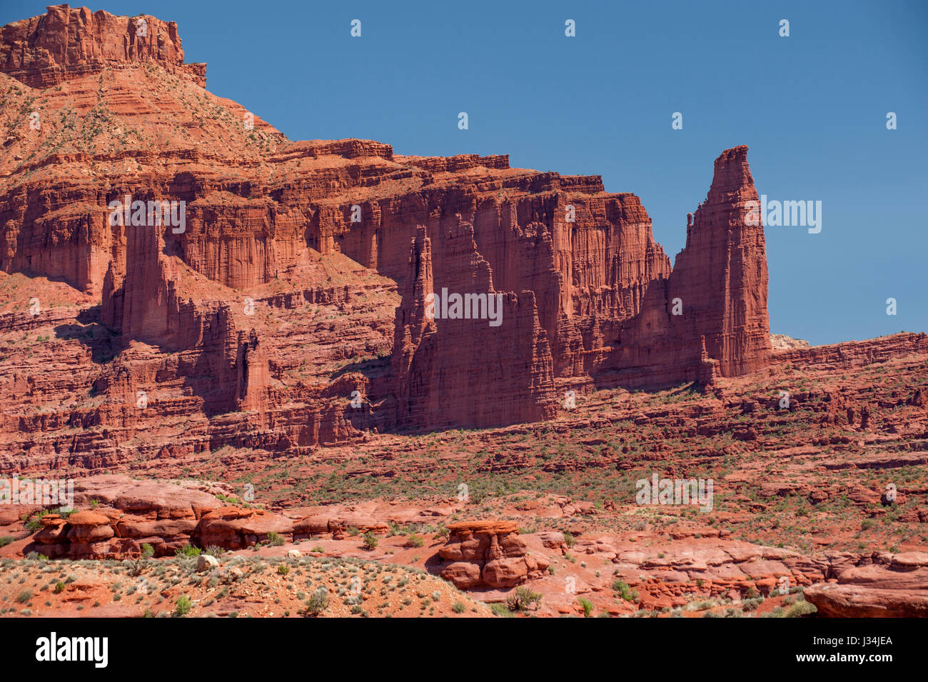 Fisher Towers, about 20 miles east of Moab, Utah, are differentially-eroded fins of Cutler Formation arkose, capped - Stock Image