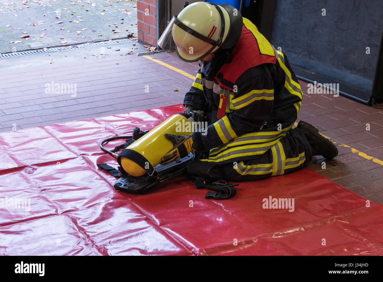 German Firefighter in action with oxygen tank - Stock Image