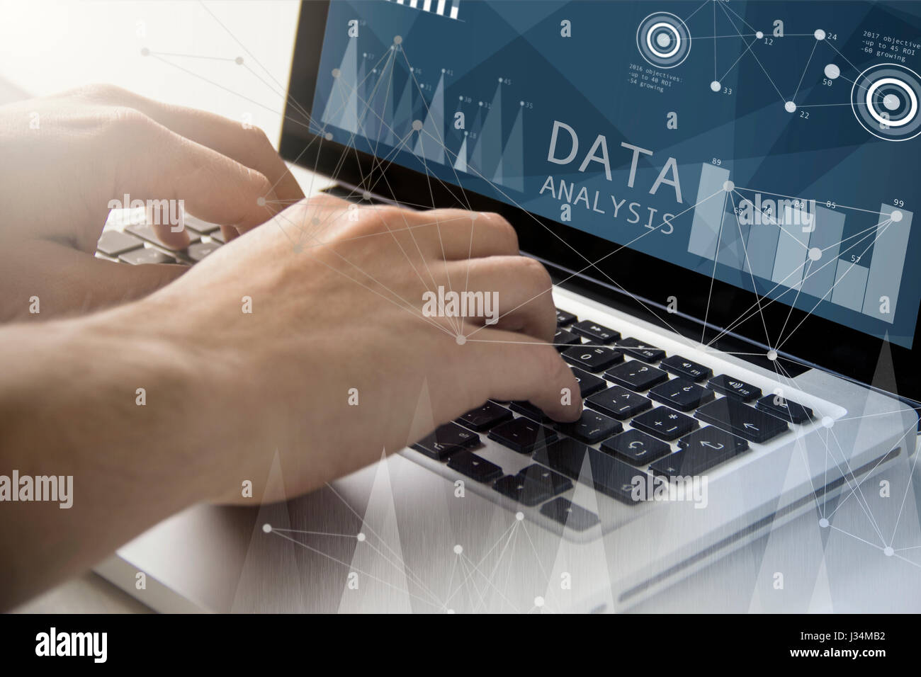 technology and business concept: man using a laptop with data analysis on the screen. All screen graphics are made - Stock Image