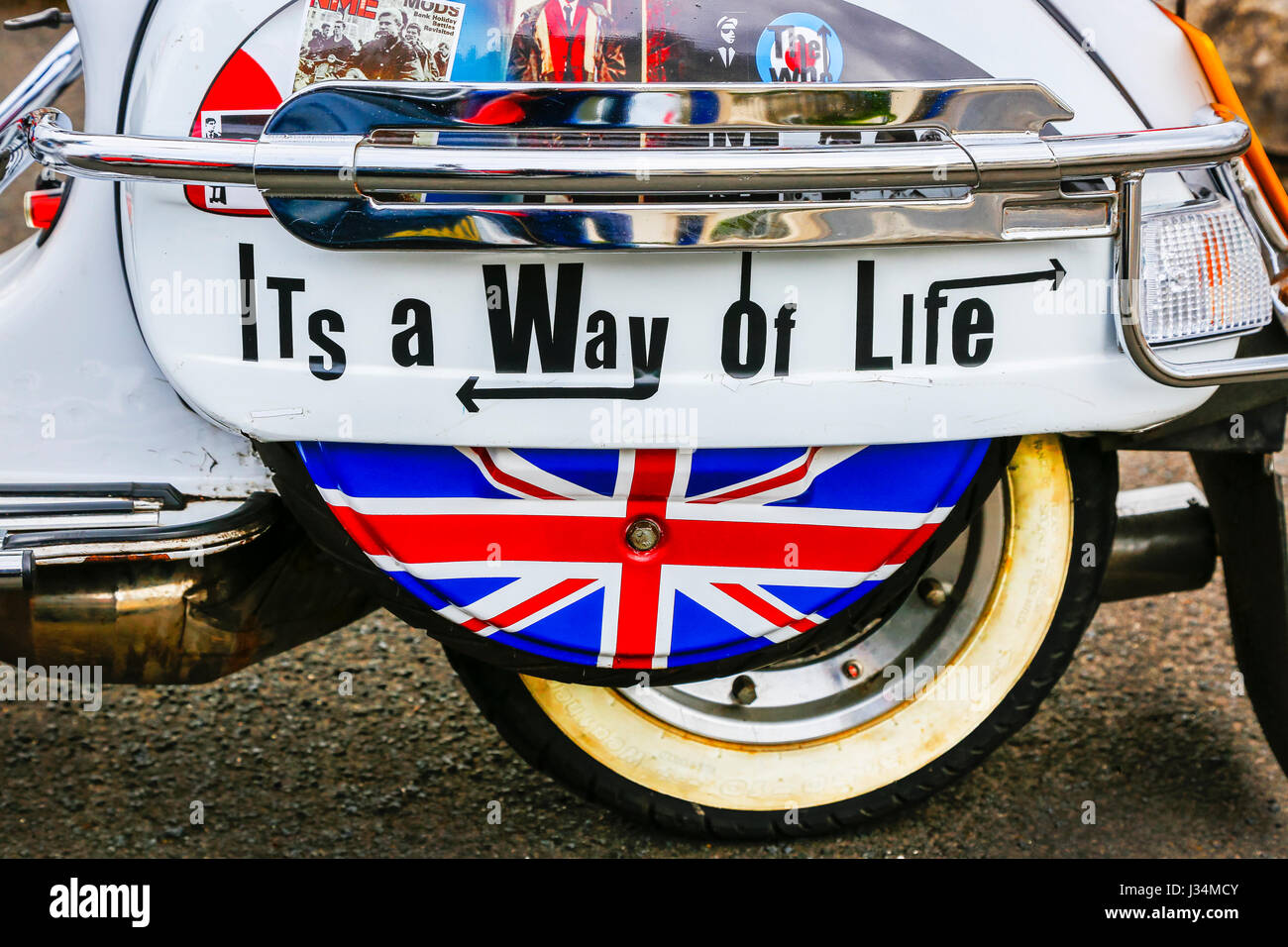 MOD decorated scooter with Union Jack and stickers promoting the Mod way of life, Scotland, UK - Stock Image