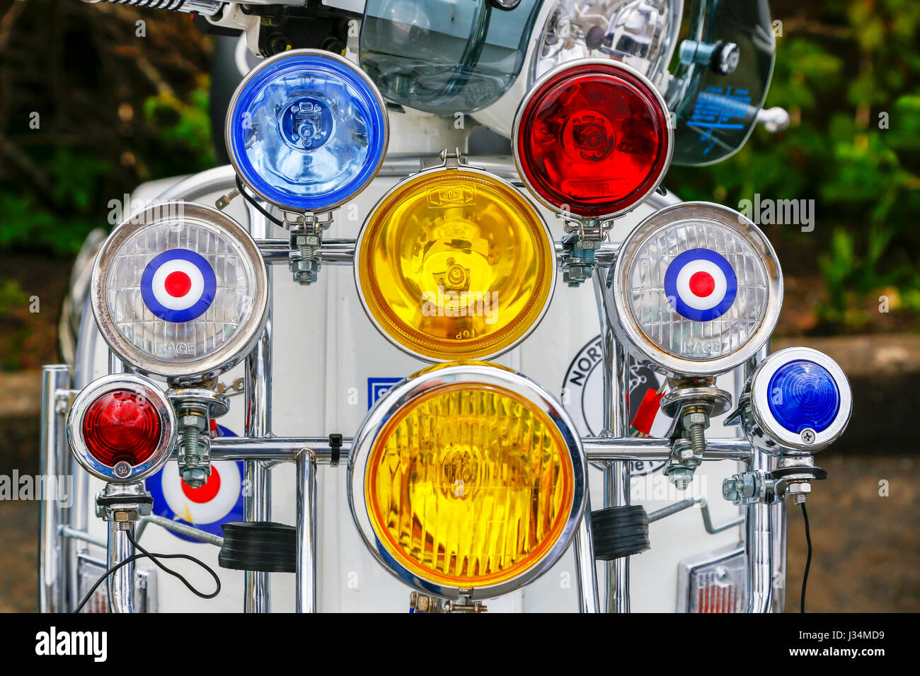 Headlights and spotlights on a Scooter decorated in Mod design - Stock Image