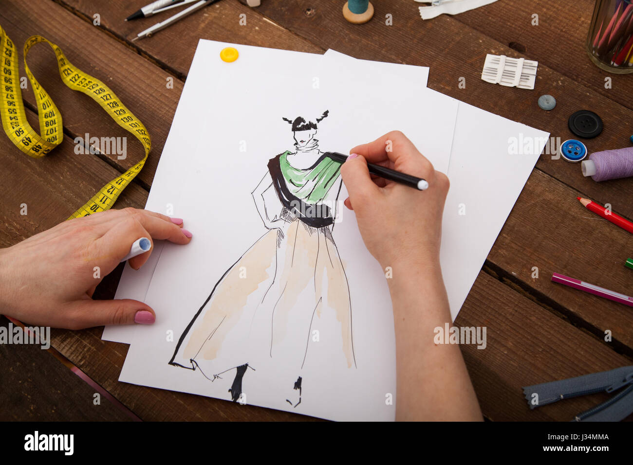 Clothes Design Drawings | Fashion Designer Drawing New Models Of Clothes Stock Photo
