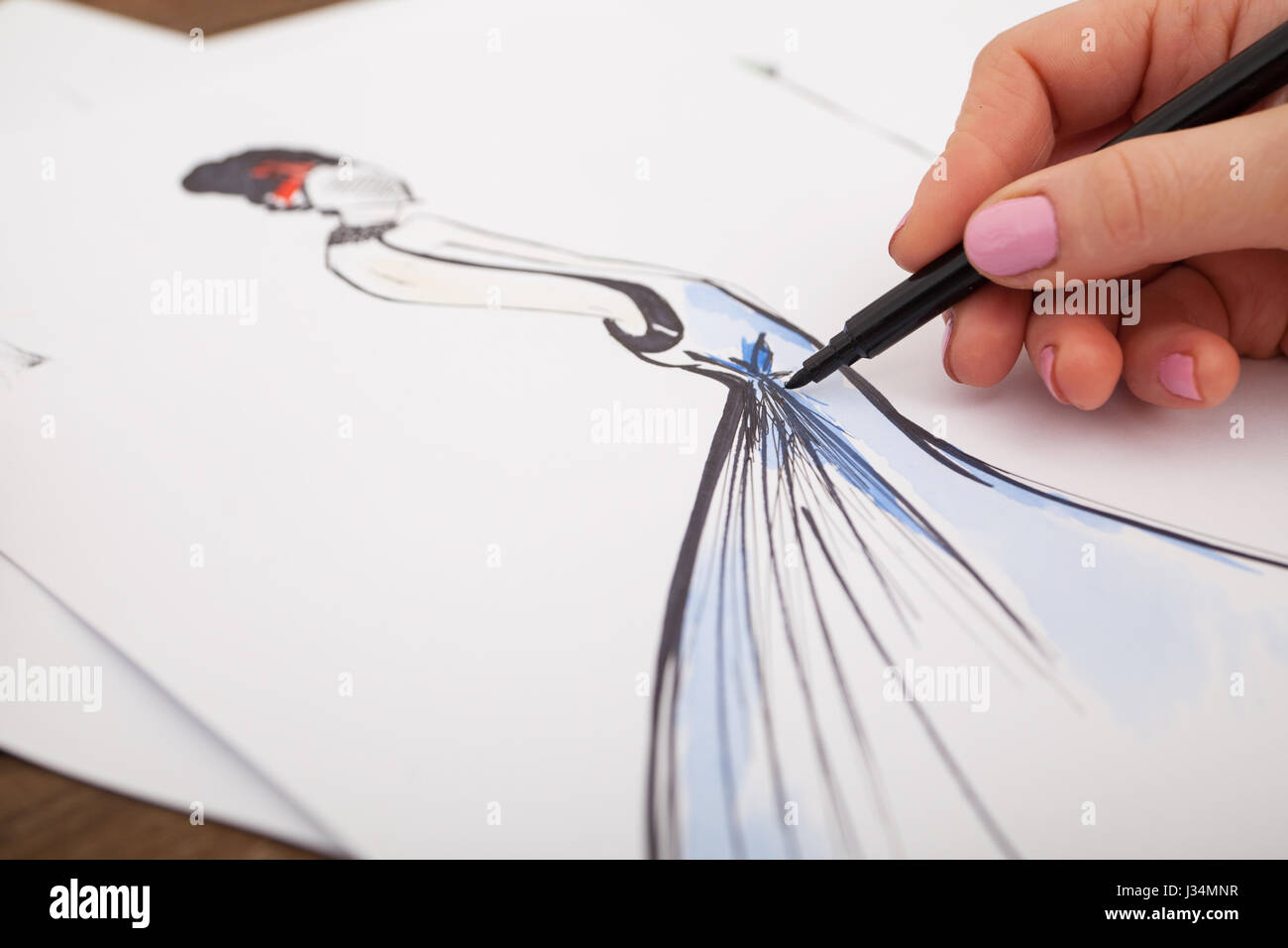 Fashion Designer Drawing New Models Of Clothes Stock Photo