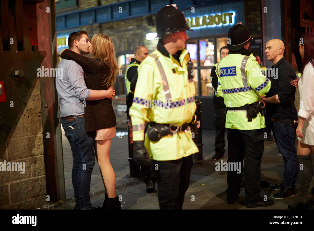 Manchester city centre , late night  kiss outside the Printworks complex - Stock Image