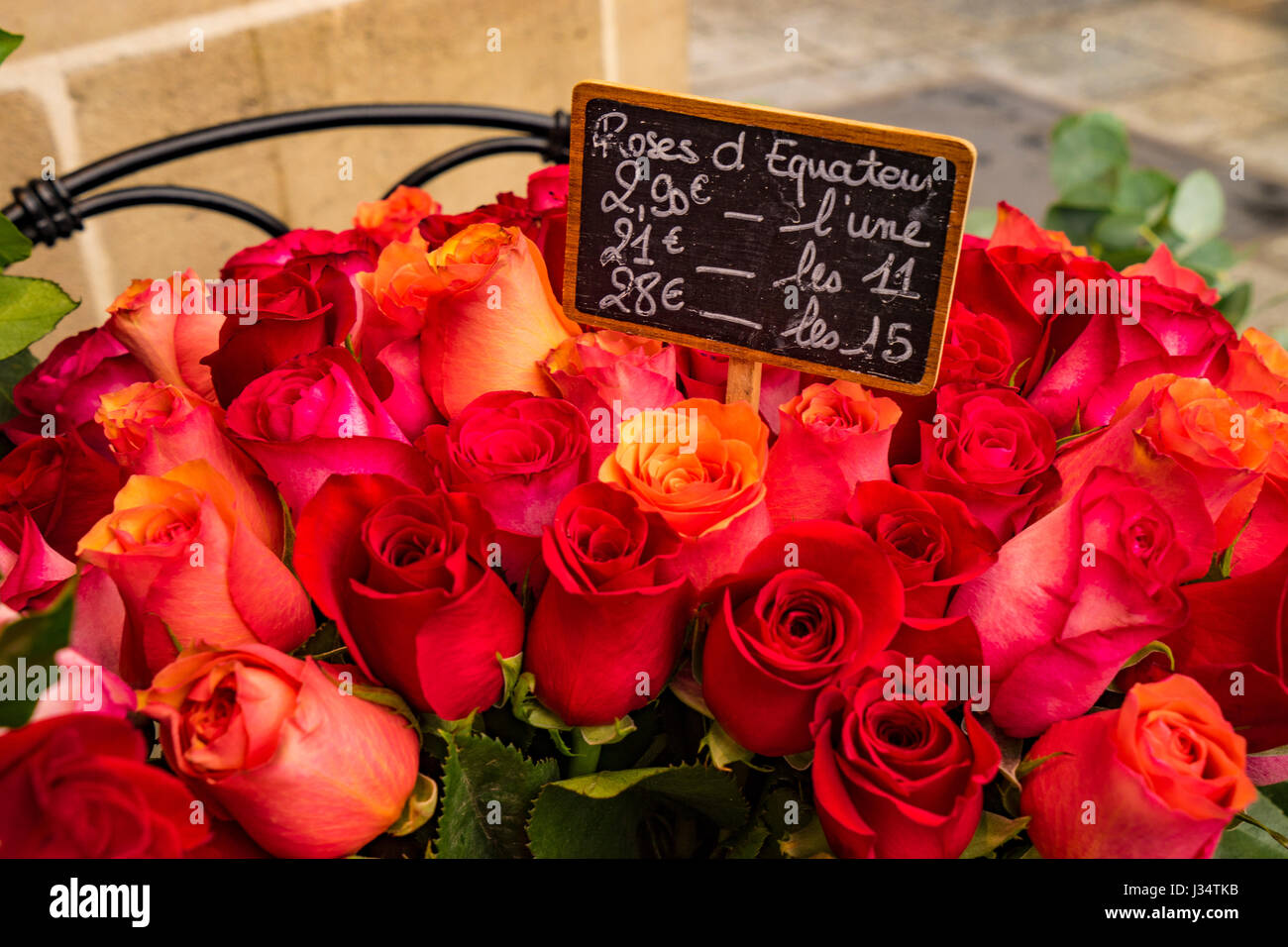 Roses for sale in Paris flower shop with labels displaying