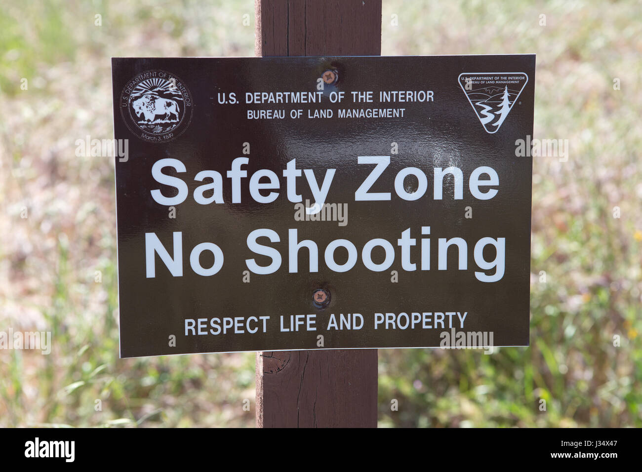 US Department of interior, Bureau of land management  Safety zone . No Shooting sign .Respect life and property. - Stock Image