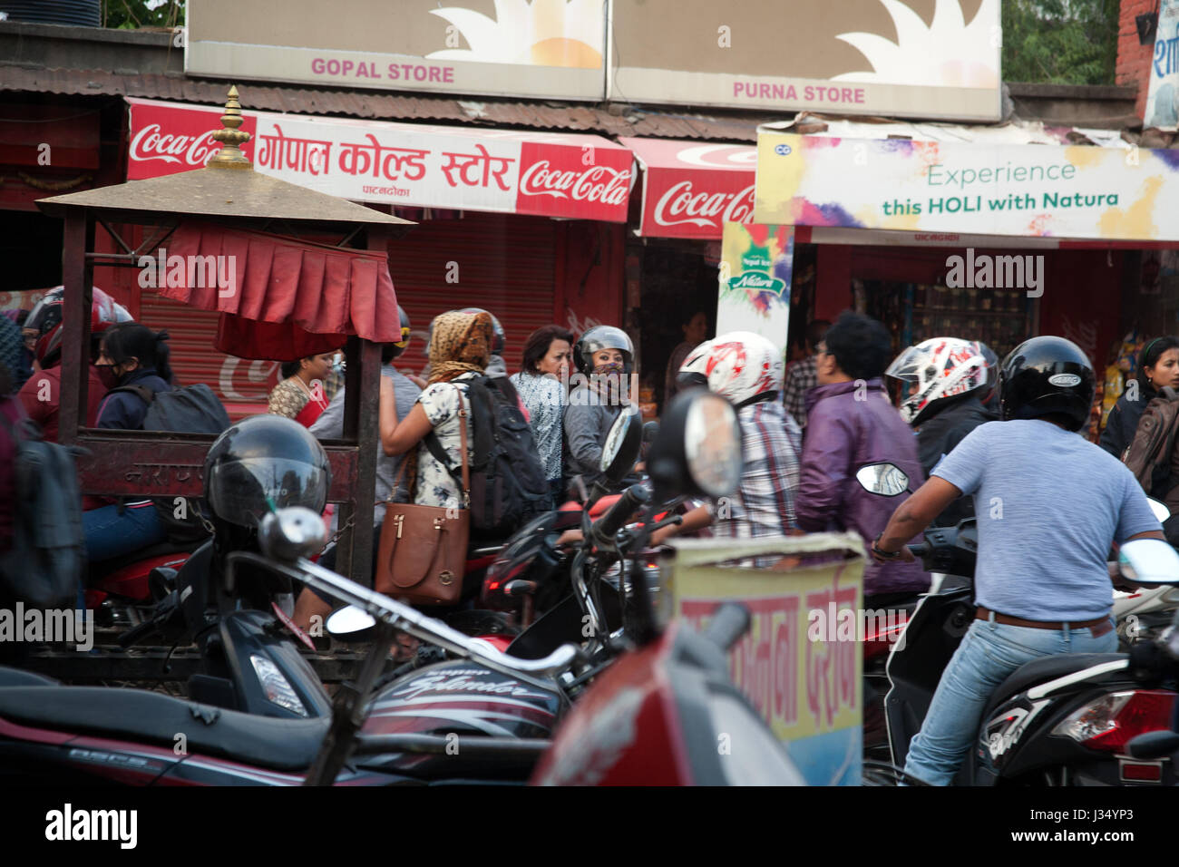 Busy street corner with mopeds and heavy traffic, Patan, Nepal - Stock Image