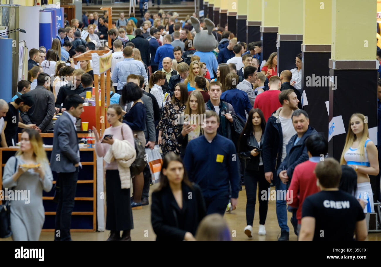 People attend business conference in congress hall - Stock Image