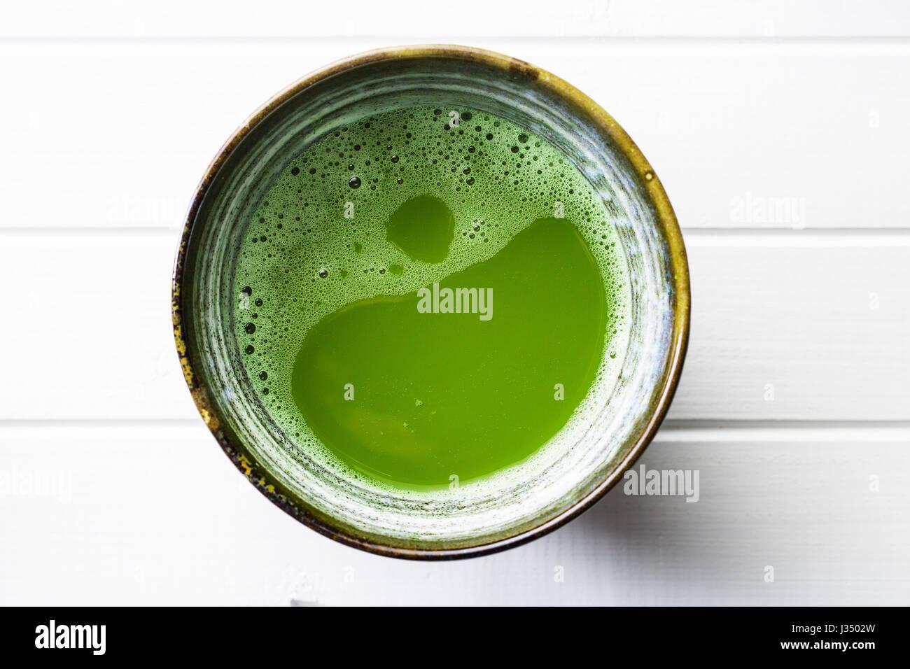 Green matcha tea in bowl. - Stock Image