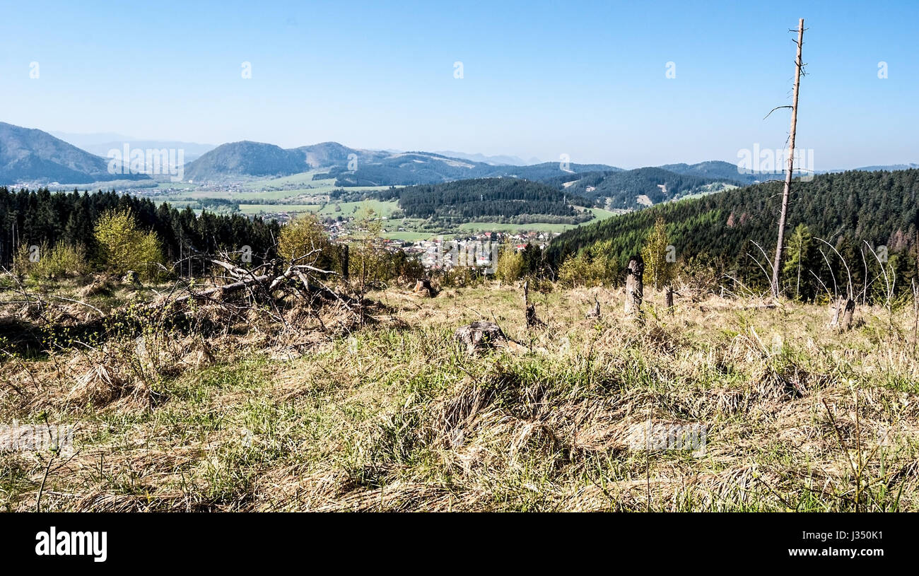 mountain landscape of Kysuce region in Slovakia with villages, countrysides, hills, meadow and clear sky - Stock Image