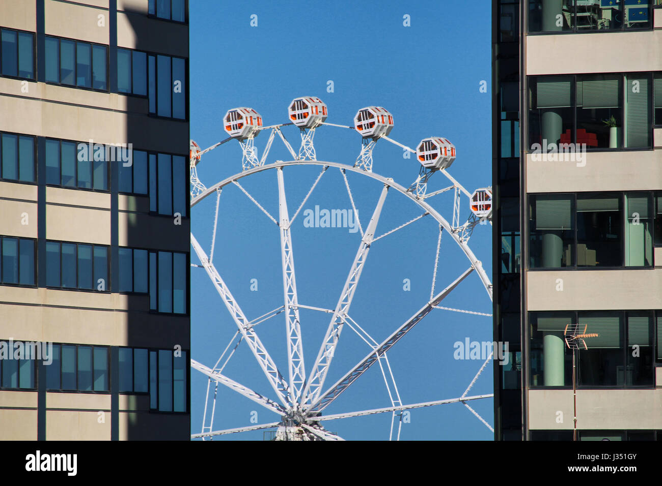 BARCELONA/SPAIN - 1 MAY 2017: Carousel between two skyscrapers at Barcelona's Feria de Abril near Forum - Stock Image