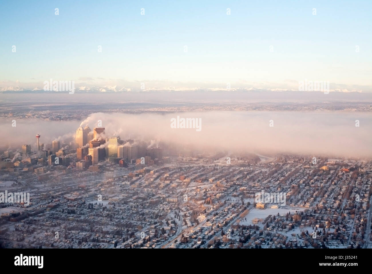 Emissions from downtown buildings during cold weather - Stock Image