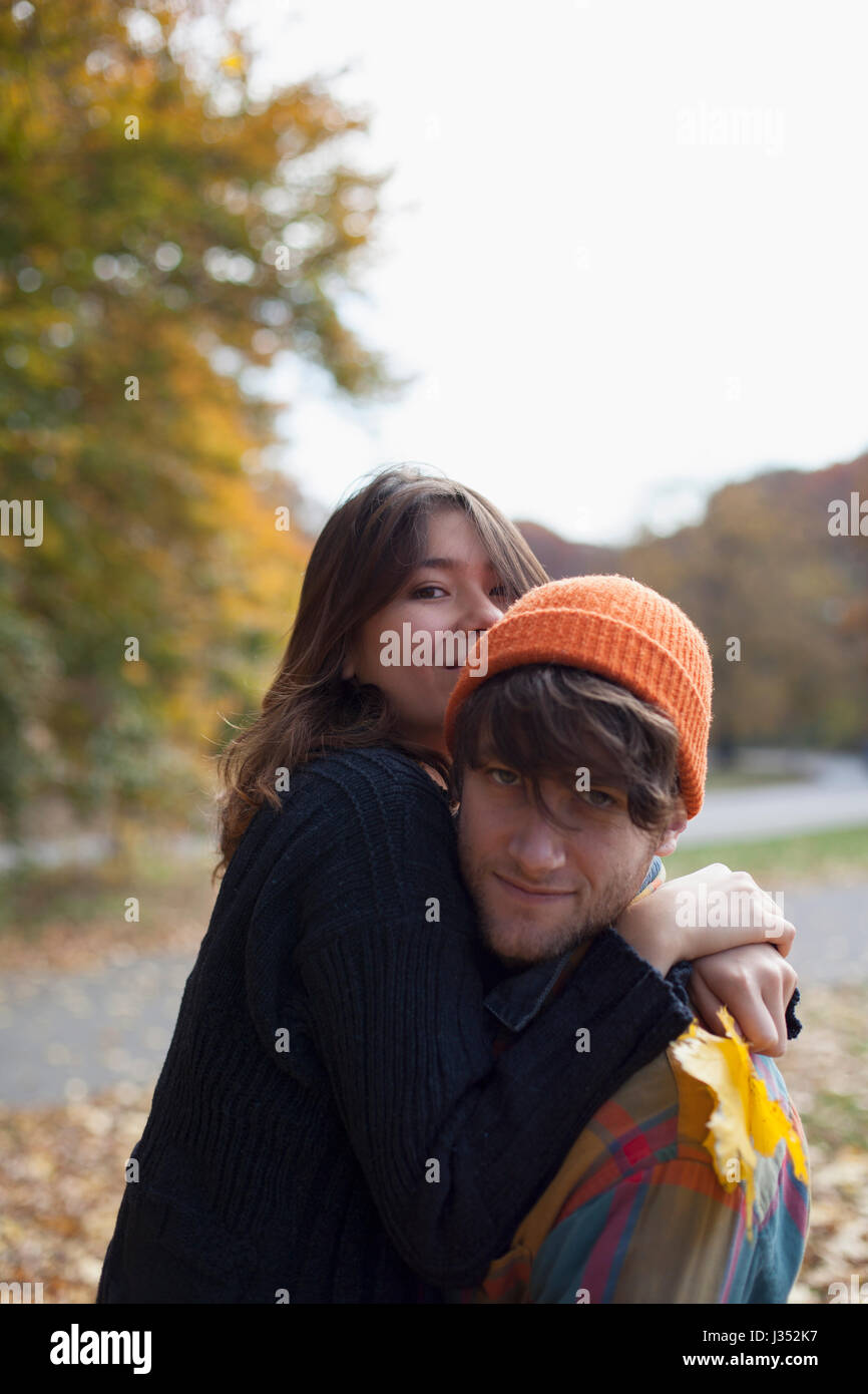 Portrait of a young couple embracing - Stock Image