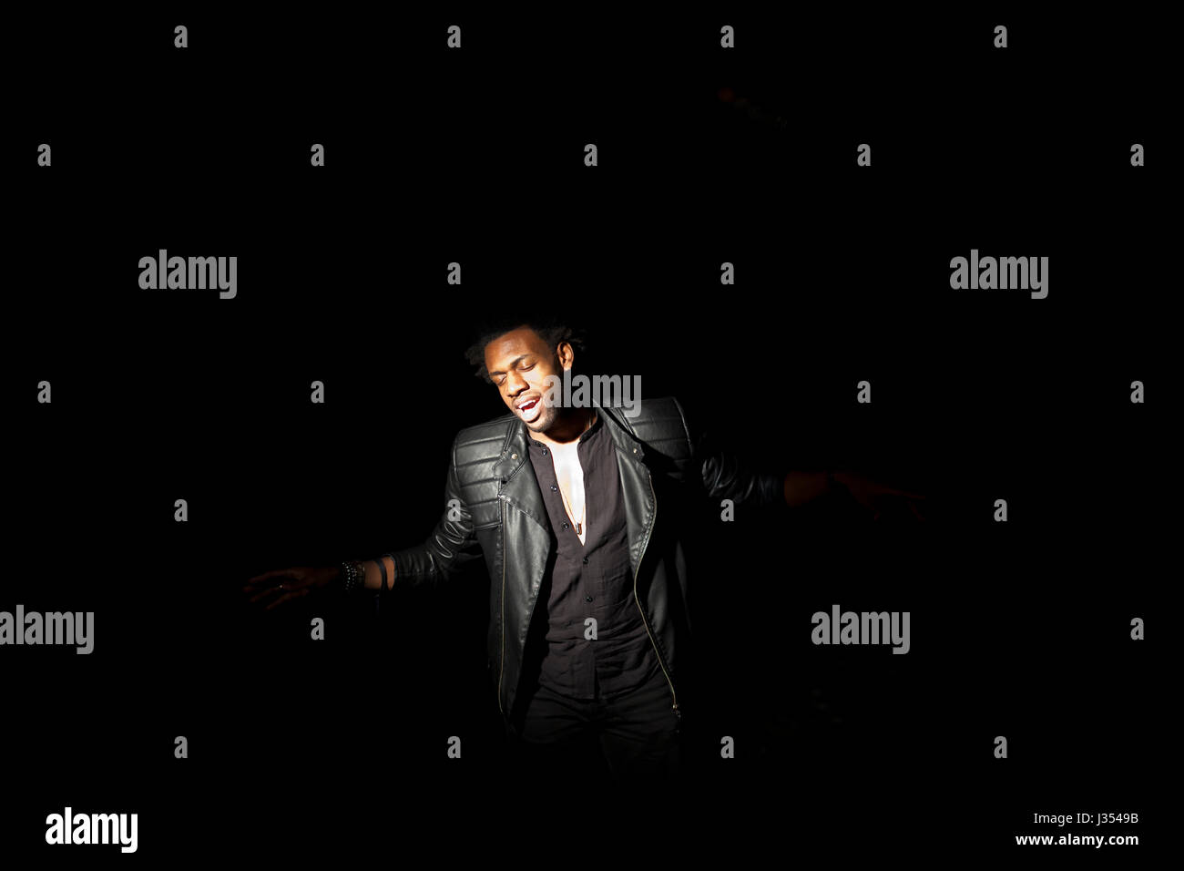 Young actor performing on stage - Stock Image
