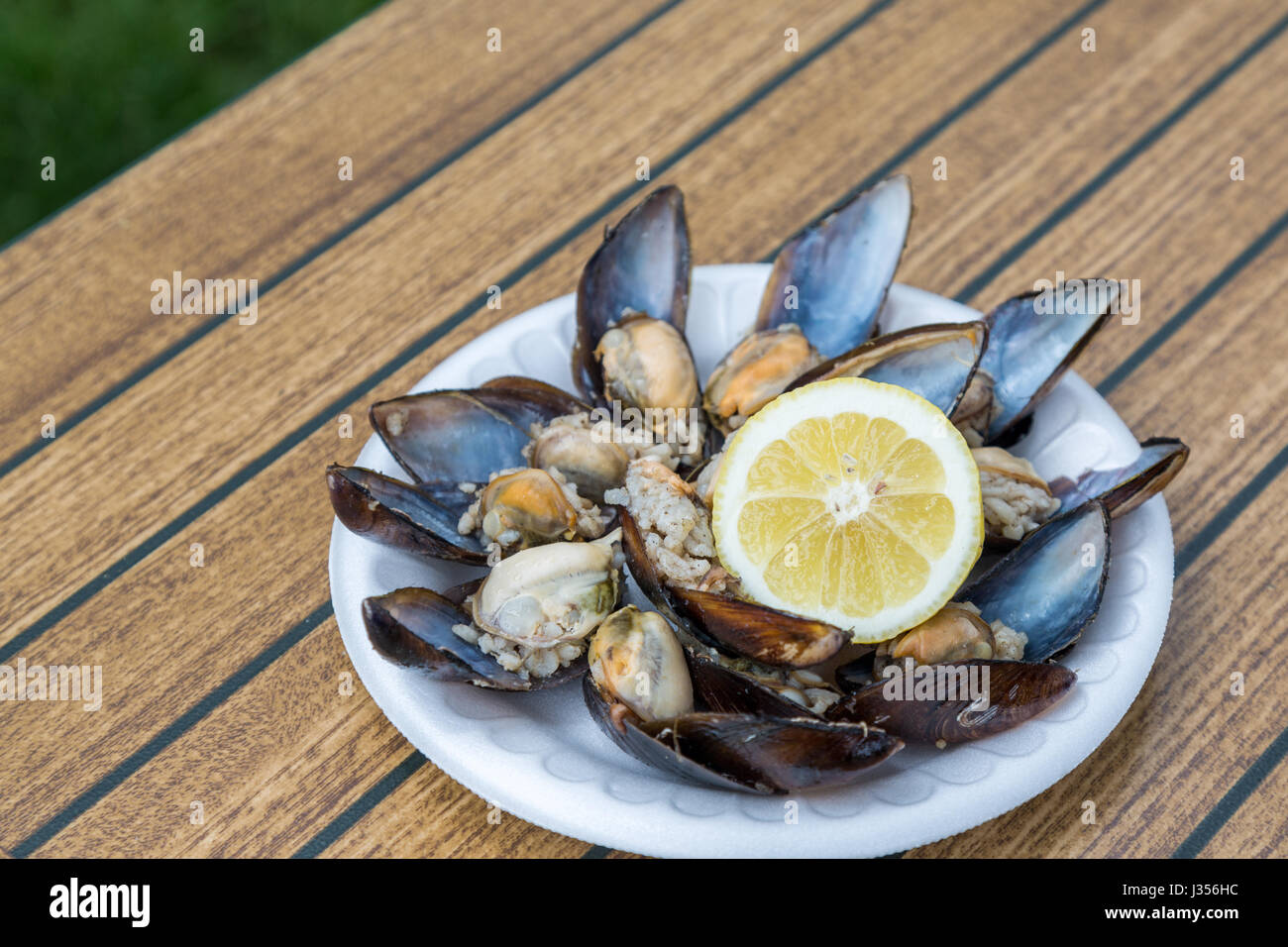 Stuffed mussels with lemon - Stock Image