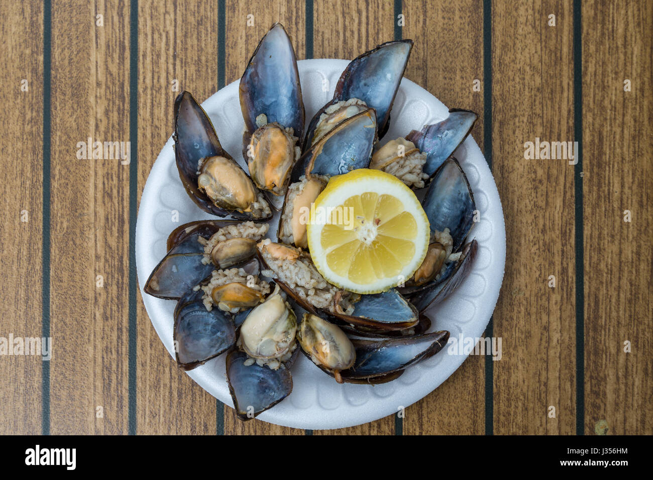 Stuffed mussels with lemon top view - Stock Image