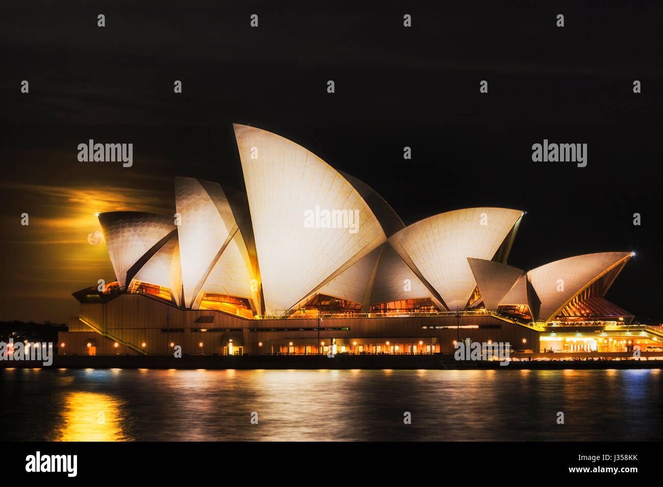 Sydney, Australia - 15 November 2016: Super moon unique astronomical evant of rising moon over world famous Sydney - Stock Image