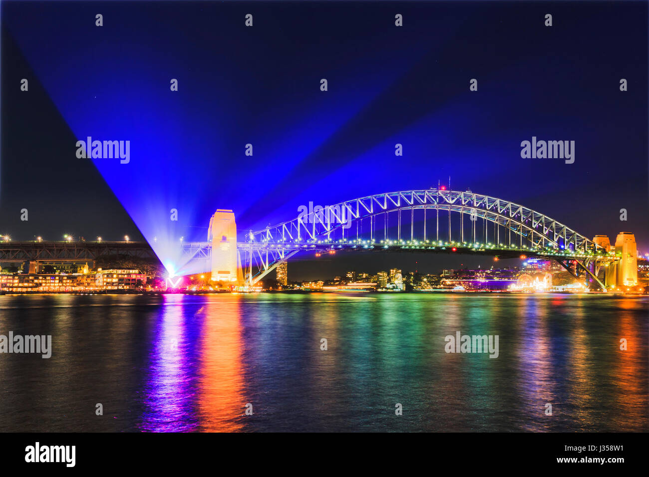 Projection from The Rocks under the Sydney Harbout bridge during Vivid Sydney light show festival. Illuminated arch - Stock Image