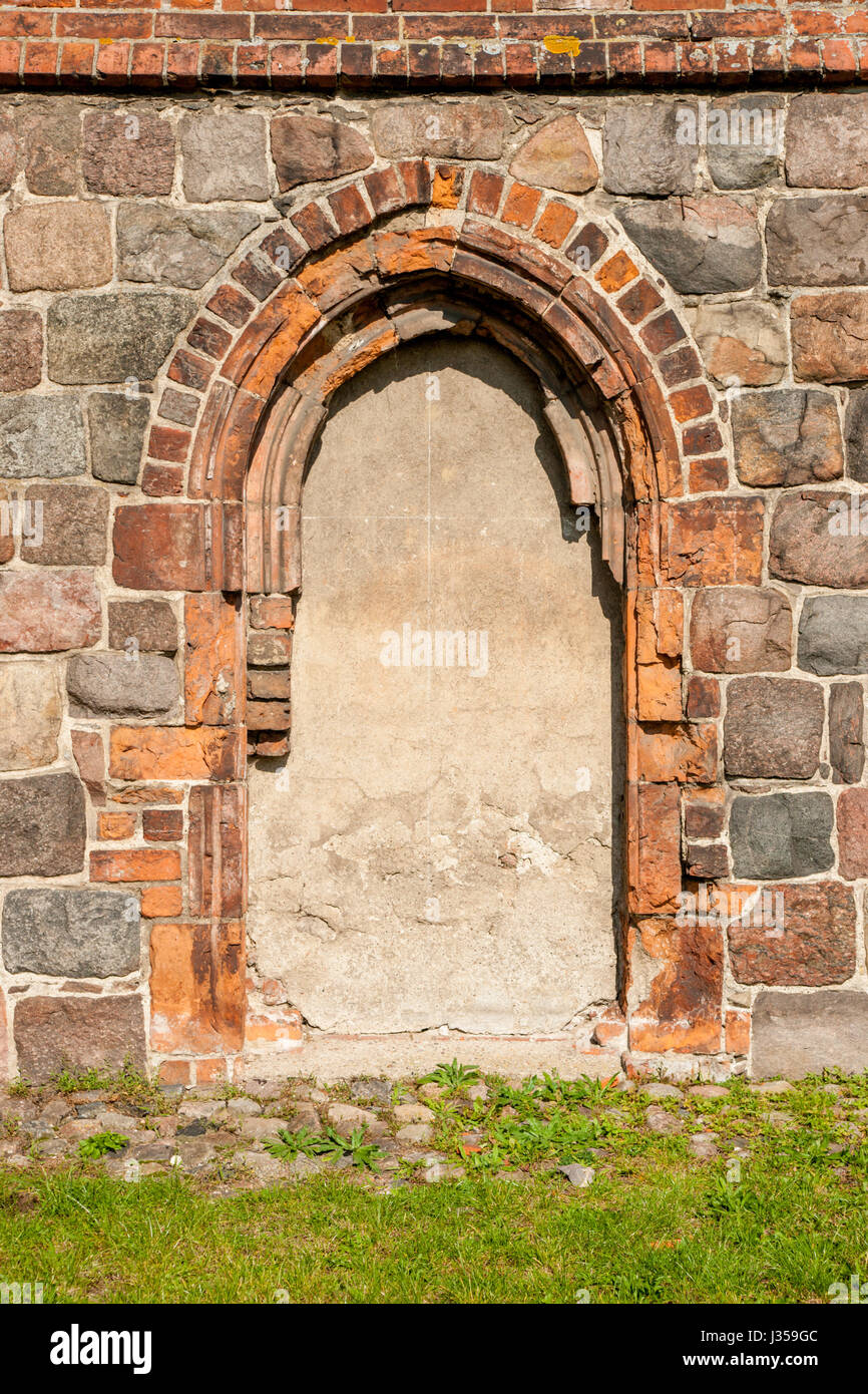 Chwarszczany - Chapel of the Templars Order - walled side entrance to the chapel - Stock Image