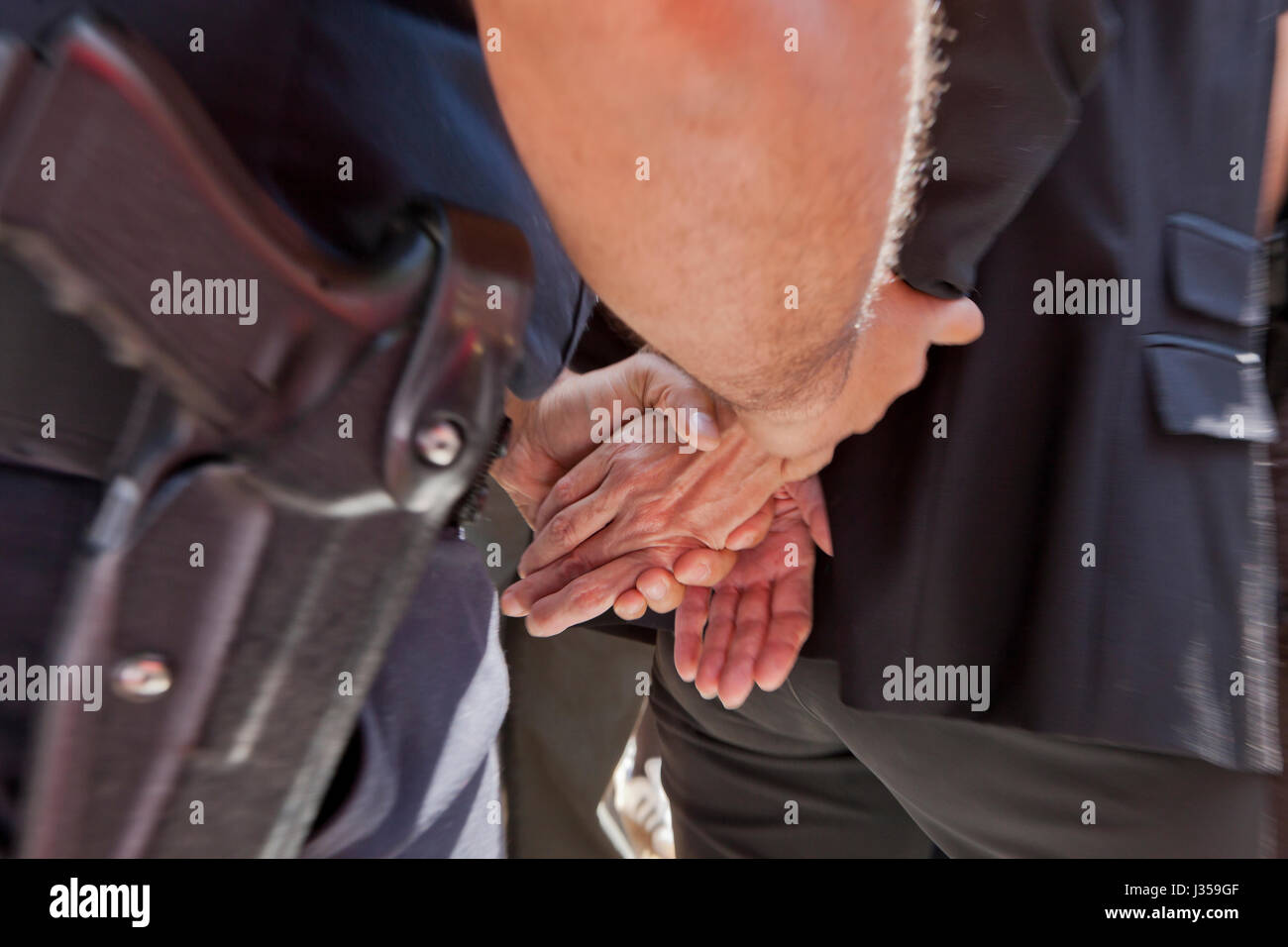 Woman being arrested and handcuffed by police - USA - Stock Image
