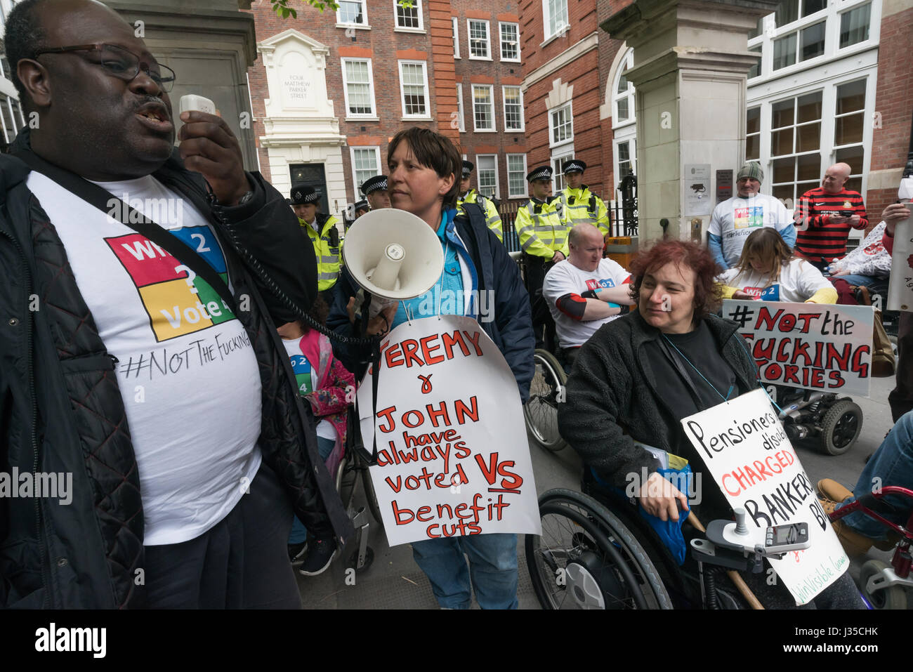 London, UK. 2nd May 2017. A DPAC member speaks in front of the Tory HQ, in the protest by Disabled People Against - Stock Image
