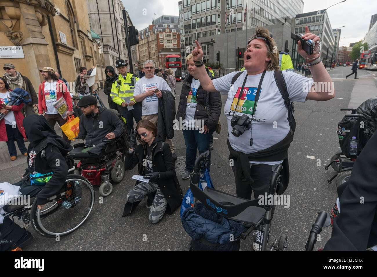 London, UK. 2nd May 2017. Paula Peters of Disabled People against Cuts (DPAC) speaks as they block Victoria St on - Stock Image