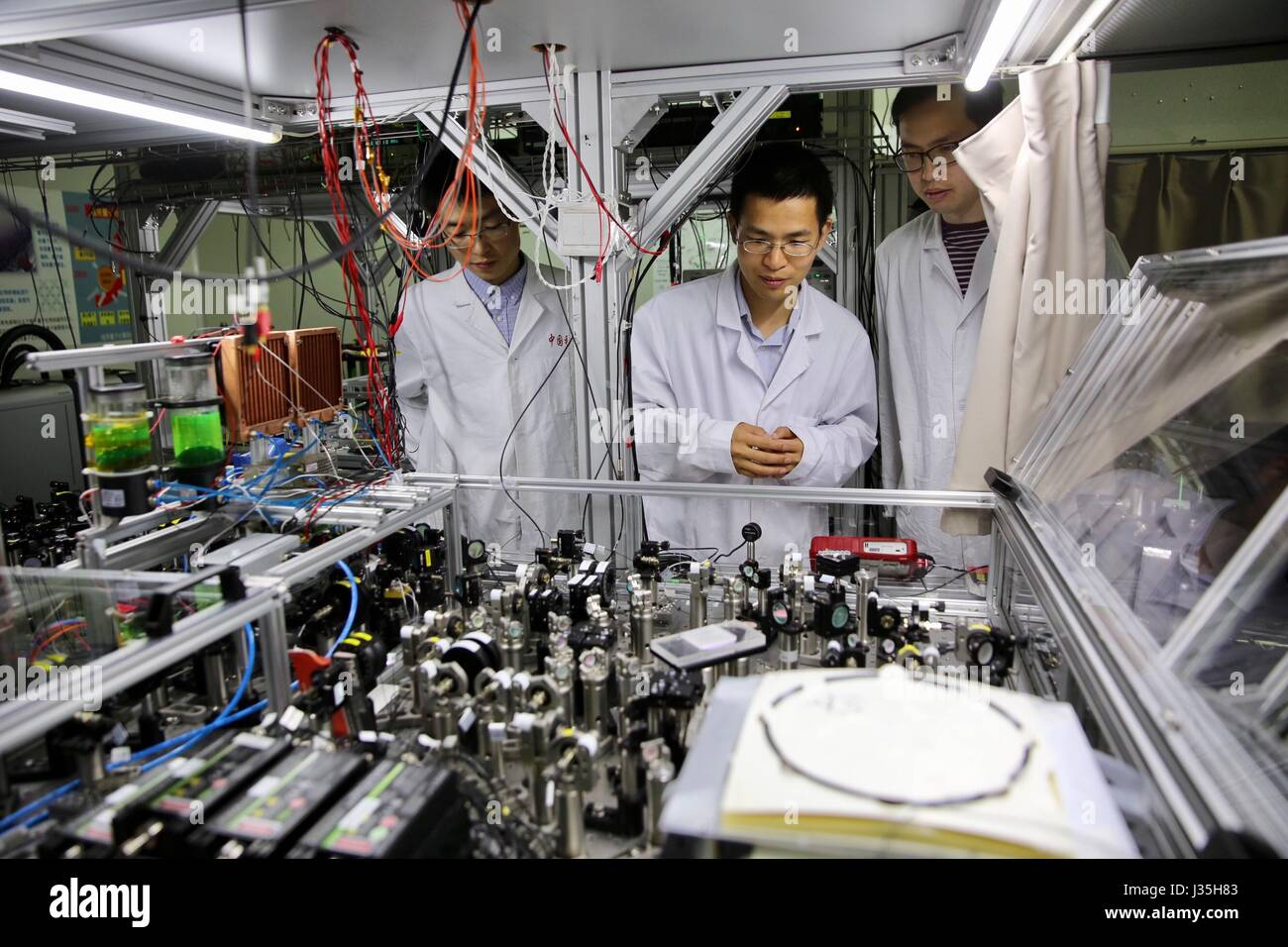 Shanghai, China. 3rd May, 2017. Professor Lu Chaoyang (C) of the University of Science and Technology of China checks - Stock Image