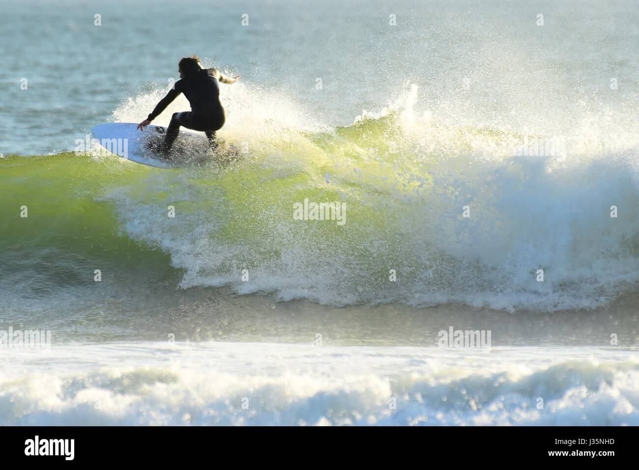 Aberystwyth Wales UK, Wednesday 02 May UK UK Weather: surfers enjoying riding some fine waves off the beach at Aberystwyth - Stock Image