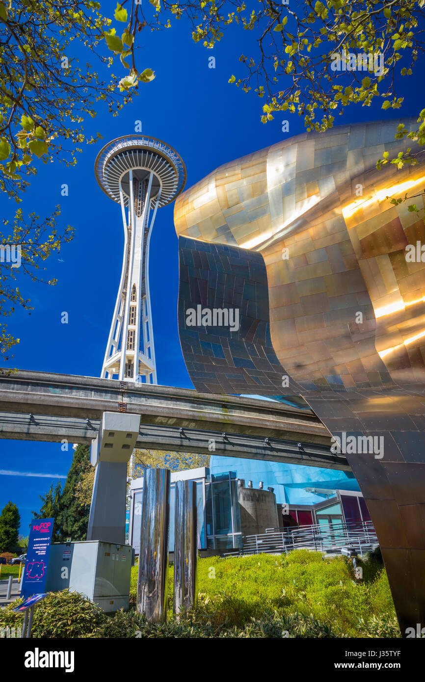 Space Needle and the Experience Music Project (EMP) building at Seattle Center. Seattle Center is a park and arts - Stock Image