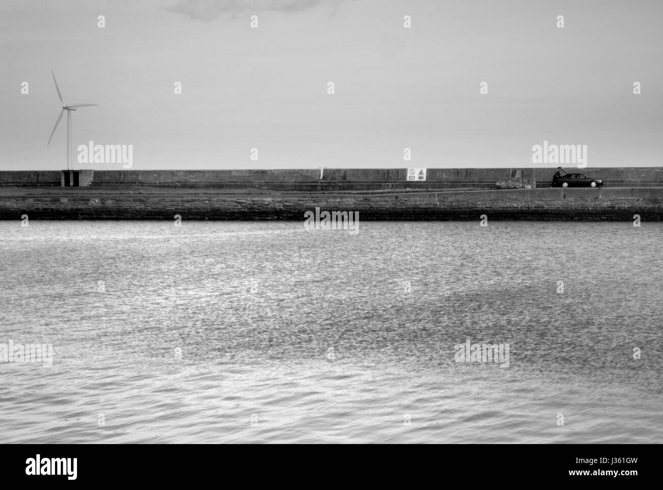 Cat parked on pier at Blyth harbour - Stock Image